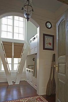 Bodacious bunkroom...but I would probably have the ladders at opposite ends