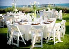 Beach reception tables flowers white & green outdoor