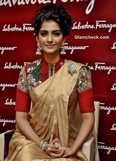Bollywood Actress Sonam Kapoor is wearing a closed neck pink heavy thread embroidered blouse for a contrast cream colour saree. Indian Look, Indian Wear, Indian Attire, Indian Style, Indian Ethnic, Indian Dresses, Indian Outfits, Ethnic Outfits, Indian Clothes