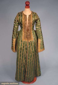 Turkey, Gold Brocade Caftan, Emerald green silk brocaded in vertical gold stripes alternating w/ small floral motifs, gold braid & galloon trim, long bell sleeve w/ slashed end, side pockets project from side of caftan, 19th C