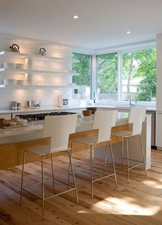 Why the designers and architects who designed these beautiful kitchens incorporating open shelving might have chosen this option to solve a design challenge they faced. | Architect: David Webber, Austin || Image Credit: Jacob Termansen