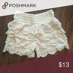Ruffled lace shorts Ruffled lace shorts Wide waistband Cream colored Size Medium fits like a small  Great used condition  Stain and tear free Comes from a pet/ smoke free home  Bundles on 3 or more get 15% off!! Paradise Shorts
