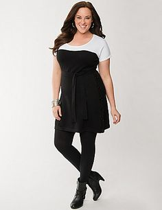 A heart-warming update to your Little Black Dress, our colorblock sweater dress will thrill you with its cozy, feel-good fit and curve-flattering silhouette. A flawless choice for day to night style, this soft sweater dress goes beyond basic with buttons down one side so you adjust how much leg to show. A sassy scoop neckline, short sleeves,  and a self-tie belt complete the look. lanebryant.com