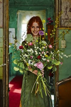 I love the emerald green and wild, natural flowers