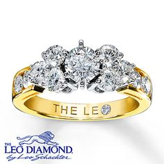 The center Leo diamond of this gorgeous engagement ring has been laser-inscribed with a unique Gemscribe® serial number and is secured by six platinum prongs and accompanied by a trio of sparking round Leo diamonds on either side. Additional round Leo diamonds accent the 14K yellow gold band. With a total diamond weight of 1 3/4 carats, the ring features independently certified Leo diamonds.