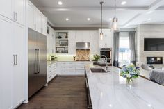 Beautiful Modern Kitchen ~ I 'Love' the Countertops and the Large Fridge!