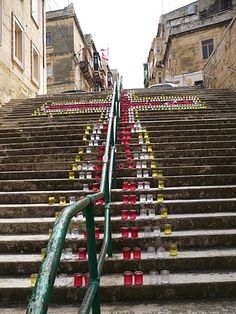 A cross made up of candles in the streets of Cospicua, Malta.