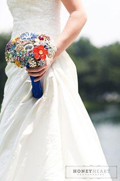 BOUQUET STYLE: colorful broach bouquet with cobalt blue ribbon wrap #jewelry_bouquet #nontraditional_bouquet