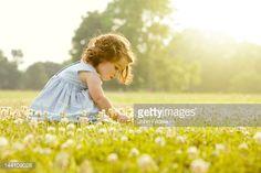 kneeling down to pick flower - Google Search