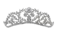 An early 19th century cut-steel tiara Of graduated openwork design, set throughout with facet-cut steel studs to a metal backing plate, one steel deficient. Image Bonhams (http://www.bonhams.com/auctions/21537/lot/199/)