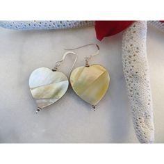 Golden lip shell earrings, Heart earrings, Shell heart earrings, Shell... ($23) ❤ liked on Polyvore featuring jewelry, earrings, lip jewelry, beach earrings, wrap earrings, iridescent earrings and shell earrings