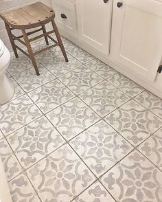 A DIY stenciled bathroom floor using the Fabiola Tile Stencil from Cutting Edge Stencils. http://www.cuttingedgestencils.com/fabiola-tile-stencil-spanish-portugese-tiles-stencils.html