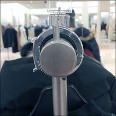 You might not find this Round Mount On Round Rail Clothing Rack interesting, except in comparison to the Rectangular mount in use just a few feet away Hardware, Sign, Bar, Detail, Clothing, Outfit, Computer Hardware, Clothes, Kleding