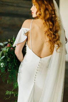 silk wedding gown - photo by Emily Sacco Photography http://ruffledblog.com/urban-garden-party-wedding