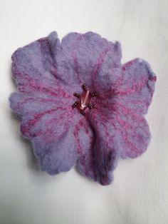 A delightful and unique handmade lilac felt flower brooch made from soft merino wool. I have embellished it with magenta mulberry silk and glass beads Blyth Whimsies