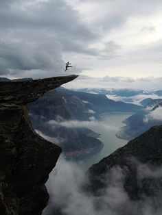 Trolltunga is a piece of rock hanging horizontally out of a mountain about 700 metres above the north side of the lake Ringedalsvatnet in the municipality of Odda in Hordaland county, Norway. http://www.flickr.com/photos/opplevoodda/7044491079/ http://abduzeedo.com/geological-photography-trolltunga