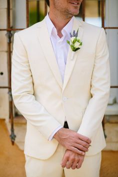 Who says the groom needs to wear black? A beautiful cream suit is perfect for an elegant and unique destination wedding like this French getaway! Photographed by Al Gawlik Photography! #bridesofaustin #austinweddings #algawlikphotography