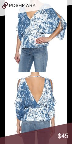 🆕NWT flowy abracadabra cold shoulder print top Soft and flattering v neck cold shoulder top from Free People. Stretchy peplum waist band, and cut out sleeves that tie at the elbows. Beautiful indigo color and tie dye/leaf print. NWT, size Small. Free People Tops Blouses