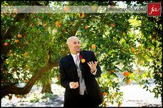Oranges prove to be a fun prop for wedding photos!