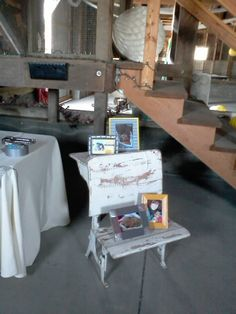 Vintage school desk with photos of the bride, groom, their puppy, and the groom's son. A beautiful piece owned by the venue....Delta Diamind Farm, Isleton, CA