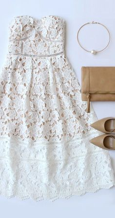 Stunning floral lace bodice with beige lining is decorated with pierced embroidery beneath a sweetheart neckline and expert tailoring. Detachable spaghetti straps are adjustable, and can be removed for a strapless look that is assisted by a no-slip strip. Flaring midi skirt completes the stunning silhouette with sheer lace towards the hem. #lovelulus: