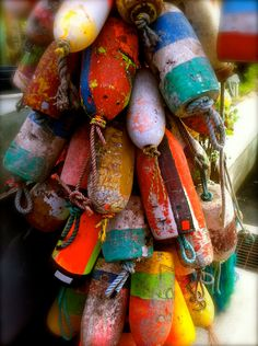 colorful buoys, hang them in the yard... I have some on my deck. Gives nautical decor a great rustic charm!