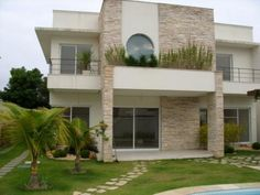 Imagen de http://www.papo10.org/wp-content/uploads/2011/08/pedra-decorativa-em-fachada-de-casa.jpg.