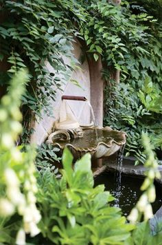 I so want a courtyard garden with a water fountain like this.