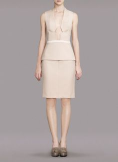 Daring cutout and proper peplum pencil skirt...awesome