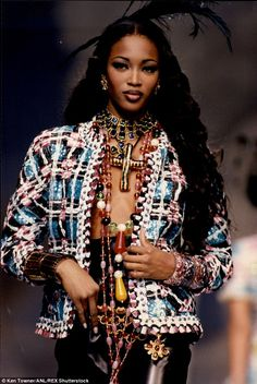Rising star: Naomi Cambell, who is pictured walking the runway in 1992, was one of the few famous black models when she started her career