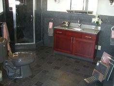 Dark accent bathroom for a show-room client by Phil Walz Plumbing