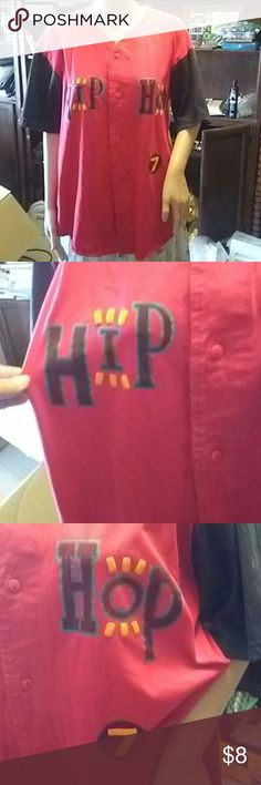 Lg Hip Hop shirt Large although there doesn't say it on the tag it seems to be cut off in that area I am sure this is a large is 50% polyester 50% cotton super cute kick around casual hip hop shirt red yellow black and a tad blue Athletic Works Tops Button Down Shirts