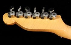 Tausch 665 Raw in Black Relic headstock back