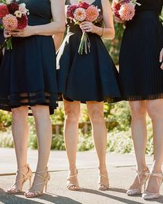 Heres a bridalparty look we can get behindblack and short mismatched bridesmaiddresses accented by various gold pumps and pops of bold dahlia filled bouquets Photo christinamcneill floral design dcwestgarden
