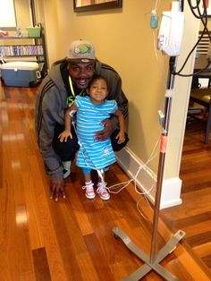Taylor and her dad enjoying a morning stroll together through the Gatewood Ronald McDonald House.