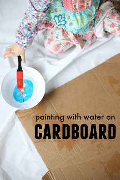 Painting with Water on Cardboard is the perfect mess-free way to let your toddler paint! A great indoor activity using recycled cardboard!