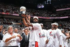 Greg Oden holding ECF trophy - Indiana Pacers vs. Miami Heat - Photos - May 30, 2014 - ESPN