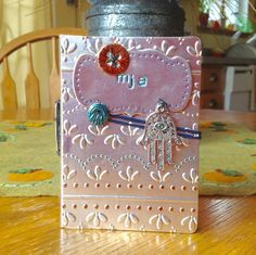 Passport book using Eileen Hull die and embossing folders by Sizzix