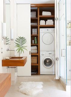 Love the clean lines and controlled white and wood color palette of this compact, modern laundry room-bathroom-hybrid.