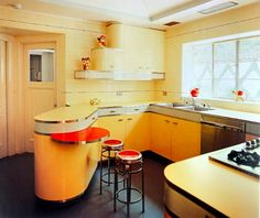 A good example of how to maintain the character of a mid-century modern kitchen. This is a little flashy for most with metallic and white banding but makes a statement. Radius corners leans the design towards Modern or Art Deco. The color is spot on for the era.