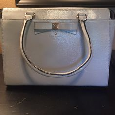 Kate Spade handbag Authentic Kate spade beacon court Jeanne handbag with shoulder and cross body strap. It is a beautiful light smoke color, never been used. Please no trades😀 kate spade Bags