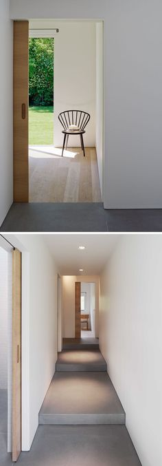 Throughout this modern house, wood pocket doors slide into the white walls, making the interior more streamlined.