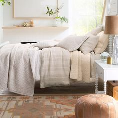 Mix warm neutrals, soft textures, and quiet patterns to create a soothing bedscape. Try layering yarn-dyed stripes from the Relaxed-Linen Collection with the scrolling vines of the Reversible Voile Quilt and the Botanical Quilt for a look that's rich in texture and dimension. Luxury Duvet Covers, Luxury Bedding, Sale Of The Day, Bedding Basics, Comforter Cover, Bedding Collections, Linen Bedding, Bed Sheets, Garnet