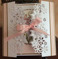 Gate fold card cut with Die'Sire Floral Dance with pearls and gems added. Magenta stamp coloured with Promarkers. TFL