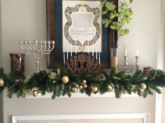 My Hanukkah decoration on our fireplace mantle this year! My menorah's go great with my ketubah..