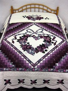 """Not only do I just LOVE this quilt's beauty, but I have the very same 'floral' as accent colors in my living room!  I made 4 """"quillows""""  from the purple/mauve/teal Remembrance floral print.  A 'Quillow'  is a 45""""x72"""" quilt, with a 22"""" square pillow sewn on one end.  A person can fold up  tuck the entire Q into it, for a Pillow... OR when it's opened flat, like a covering, you can put the pillow part down so you can put your feet in it,  keep them warm while watching TV!"""