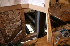 Replacing more of the flooring. Light from the basement pours between the Joists.