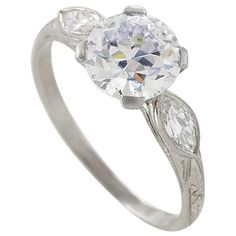 Art Deco Diamond Platinum Engagement Ring centers on a round old European-cut diamond that weighs 1.59 carats. Circa 1920's.