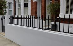 Plastered rendered front garden wall painted white metal wrought iron rail and gate victorian mosaic tile path in black and white scottish pebbles York stone balham london (34)