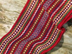Cdn Metis Arrow Sash - red represents the blood thatwas shed through the years; blue is for the depth of their spirits; green is for the fertility of a great nation; white is for the connection to the earth and the creator; yellow is for the prospect of prosperity